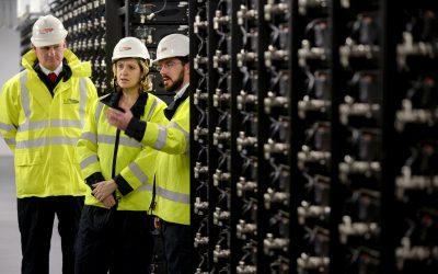 Former UK energy minister Amber Rudd (centre), on a 2015 visit to the country's first large-scale battery project, which connected to the grid as a demonstration project in 2014.