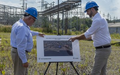 South Amboy's Mayor Fred Henry (left) with Rise Light & Power CEO Clint Plummer take a look at the plans. Image: Rise Power & Light.