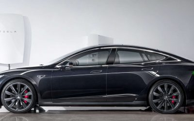 Tesla Model S EV with a Powerwall home storage unit in the background. Image: Tesla.